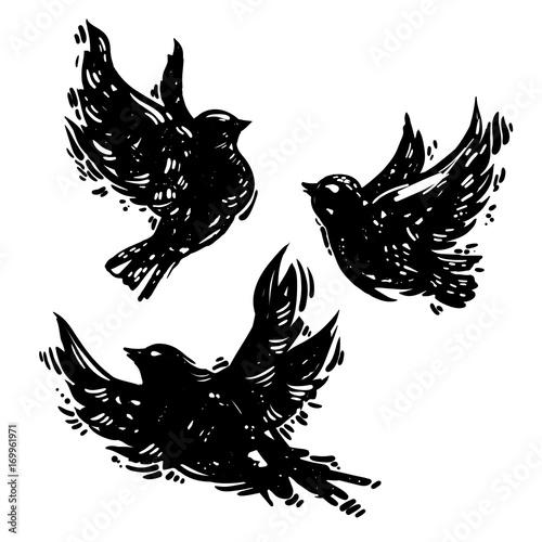 Hand drawn linocut style vector set of flying birds