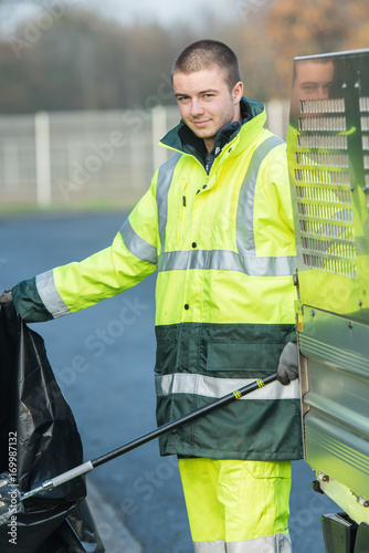 obraz lub plakat male garbage collector cleaning the streets