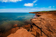 Red rock cliff and clear water at Cavendish, Prince Edward Island