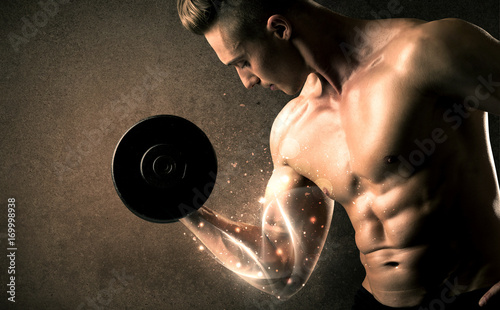 Wall mural Bodybuilder lifting weight with energetic white lines concept