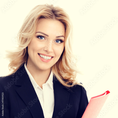 Young smiling businesswoman with red folder