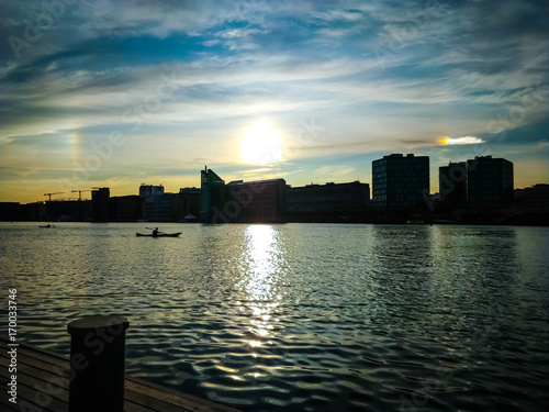 Sunset with a Rainbow Sky reflection in the Copenhagen harbour - Islands  Brygge Poster