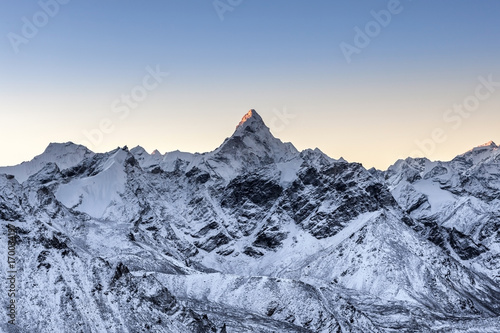 Beautiful Ama Dablam peak lit by the very first ray of morning sun Poster