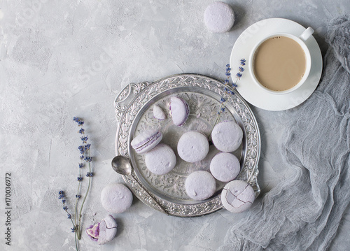 Papiers peints Lavande Macarons in bowl and on table with cup of coffee and lavender.