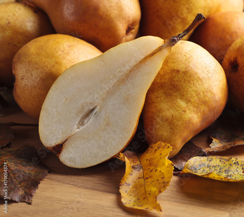 Juicy ripe pears and dried up leaves .