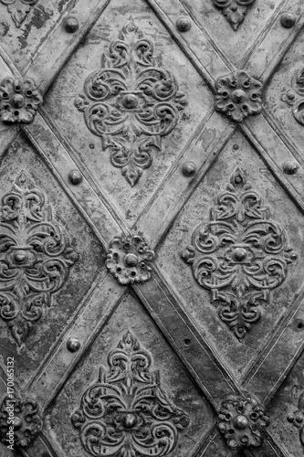 Fotobehang Abstractie Black metal texture floral pattern background. Forging. Fasteners.