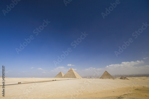 Great Giza pyramids and blue sky with clouds