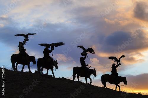 Silhouette of Mongolian Eagle Hunters near Ulgii, Mongolia
