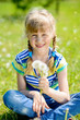 kid with dandelions
