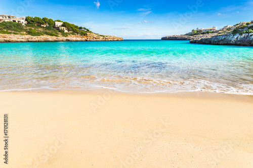 Papiers peints Tropical plage Stunning beach bay with beautiful turquoise sea water scenery on Majorca island, Spain