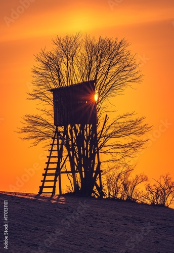 In de dag Oranje eclat Hunting tower in Carpathian mountains on colorful sunrise