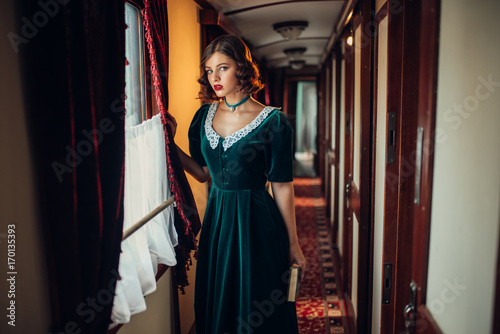 Woman in retro dress, vintage train compartment Poster