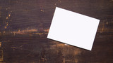 a white blank postcard on a wooden background - 170136130