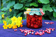 Still life with strawberry jam and yellow flowers