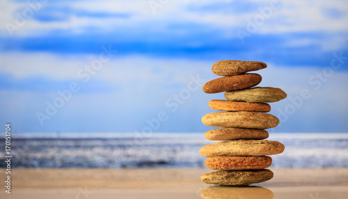 Foto op Canvas Zen Zen stones stack on blue sky and sea background