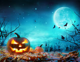 Pumpkin Glowing At Moonlight In The Spooky Forest - Halloween Scene - 170157128