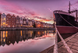 Waterfront in the evening with moored ship, Gdansk, Poland.
