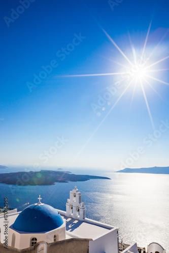 Fotobehang Natuur The Three bells of Fira and blue dome, Santorini, Greece.