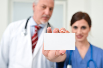 Nurse holding a business card