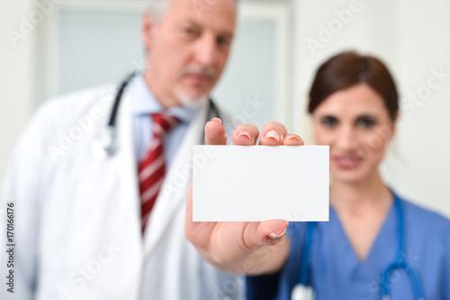 Nurse holding a business card