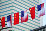 USA and China flags hanging in front of business building - 170171914