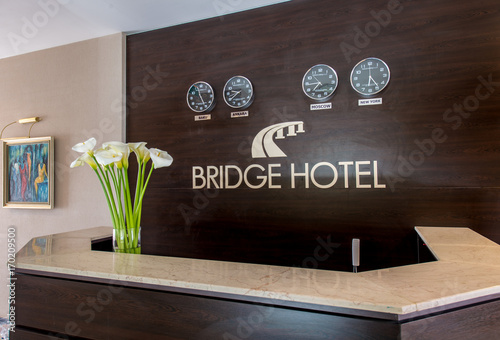 Hotel reception with desk and clocks