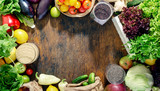 Frame of abundance of healthy food on wooden table