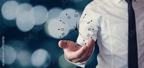 Businessman holding clock. Business time management .