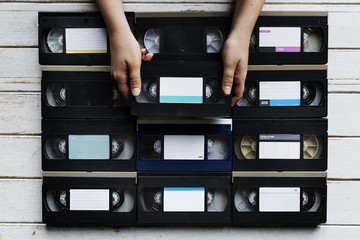 Hands holding selecting a videotape