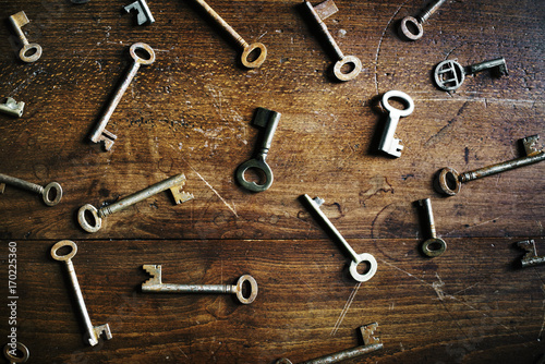 A key is isolated on wooden table Canvas