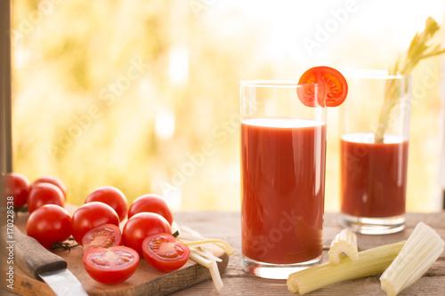 Fotobehang Sap Glasses of fresh tomato juice on wooden table