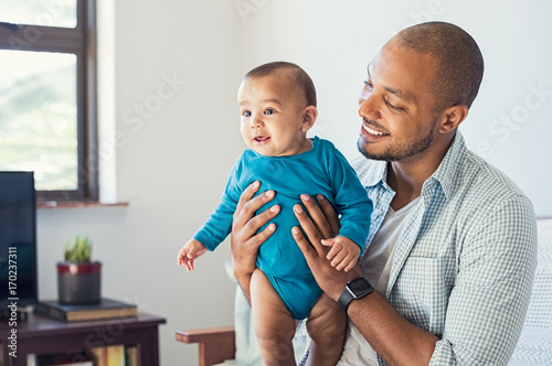 Father playing with baby