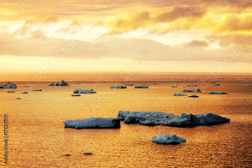 Fotobehang Antarctica Icebergs in orange sea
