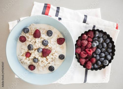 Healthy breakfast - oatmeal with blueberries and raspberries