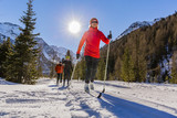 A family group of cross country skiers on a sunny winter morning in Italy Alps, South Tirol, Solda. - 170250398