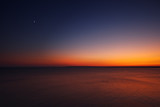 Golden sunset with moon over the black sea near cape Kaliakra, Bulgaria, aerial view