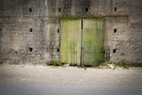 Degenerated sliding door of a deserted factory building - 170264571