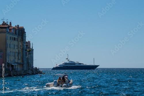 Fotobehang Schip Rovinj, Croatia - July 14th 2017: A yacht sailing by the town of Rovinj
