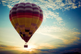 Colorful hot air balloon flying on sky at sunset. travel and air transportation concept - vintage and retro filter effect style - 170279987