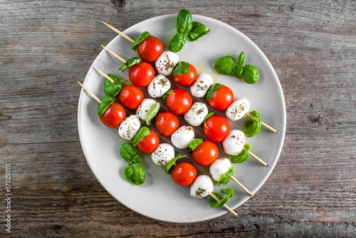 Caprese salad - skewer with tomato, mozzarella and basil, italian food and healthy vegetarian diet concept