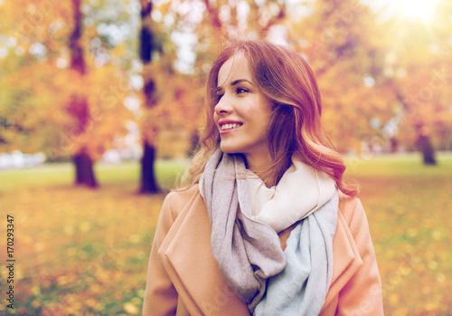 Zobacz obraz beautiful happy young woman smiling in autumn park