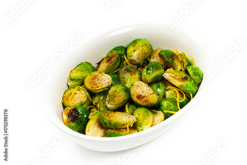 Papiers peints Bruxelles Brussels Sprouts Cabbage With Lemon Isolated on White background. Selective focus.