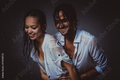 Couple sharing romantic moments under the rain Poster