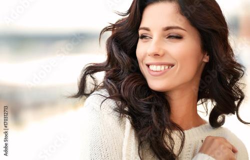 obraz lub plakat lovely beautiful woman in a woolen sweater. Beauty concept
