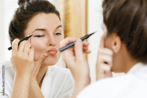 Woman is disappointed with her skill of applying makeup