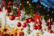 Christmas decorations and glass lanterns on a Parisian Christmas market