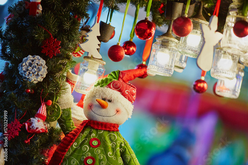 Christmas decorations and glass lanterns on a Parisian Christmas market Poster