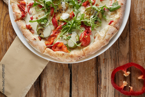 Tasty vegetarian pizza with vegetables, paper and basil. - 170349527