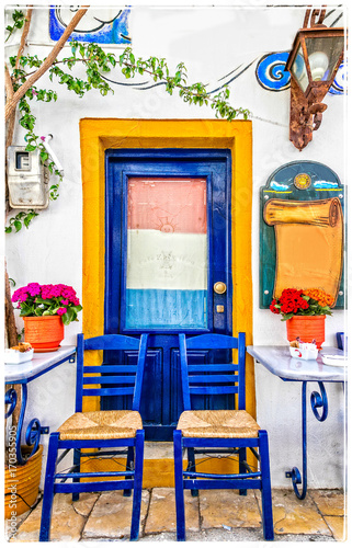 Aluminium Freesurf Traditional street colorful bars and tavernas of Greece
