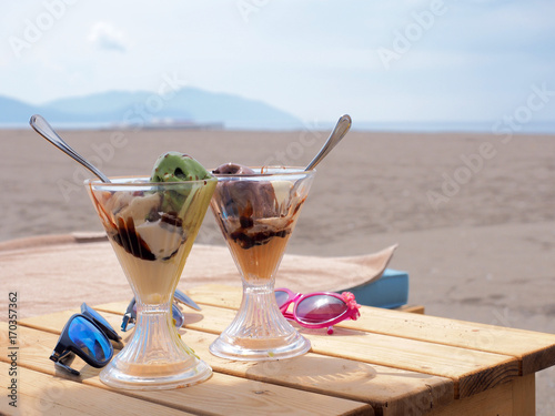 Two ice cream on the beach © shvets_tetiana